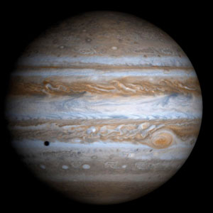 <p>Der Gasplanet Jupiter mit dem Schatten von einem seiner Monde</p>